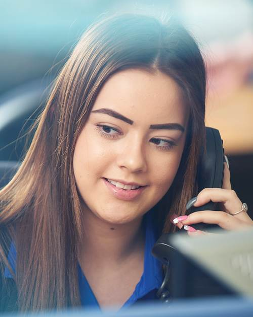 Tipton & Coseley Trainee Branch Assistant, Becky on the phone to a customer