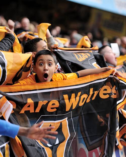 Young wolves fan celebrating goal