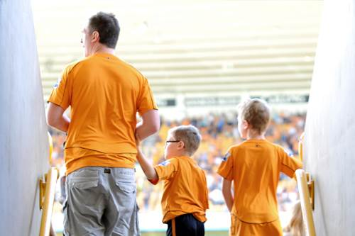 Young Wolverhampton Wanderers fans with their father