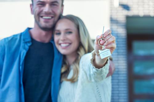 Couple holding their new house key