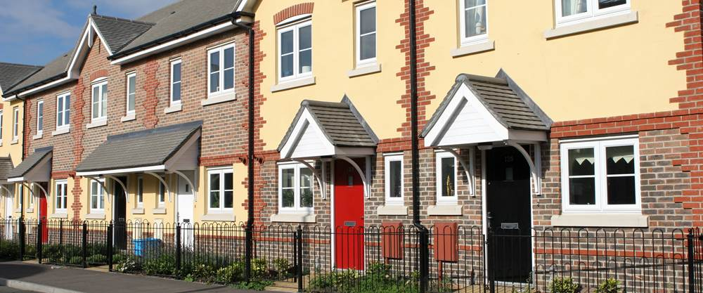 Government schemes guide tipton row of houses on a sunny street solutioingenieria Images