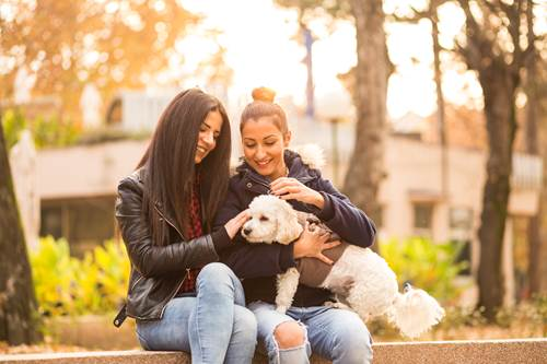 Young women in park with dog