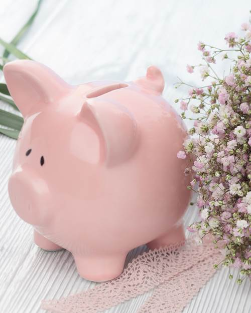Piggy bank and a wedding bouquet