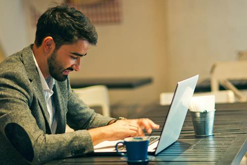 Smart man using laptop