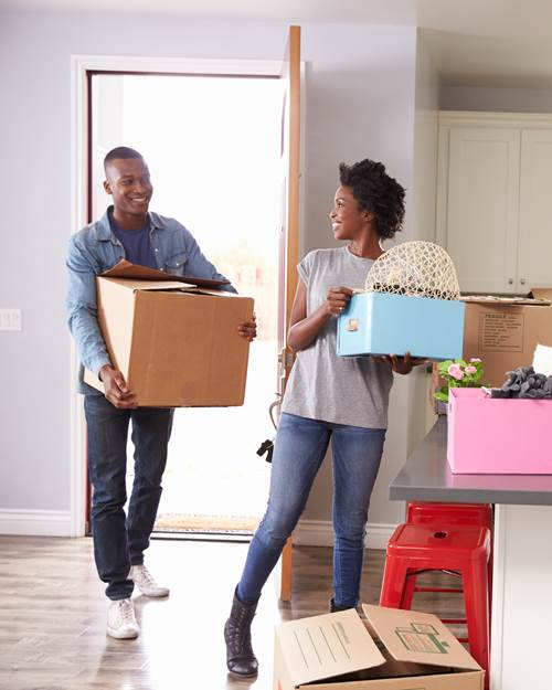 Young couple moving into their new home together