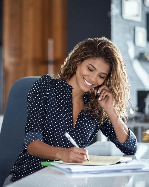 Woman taking notes from a business call
