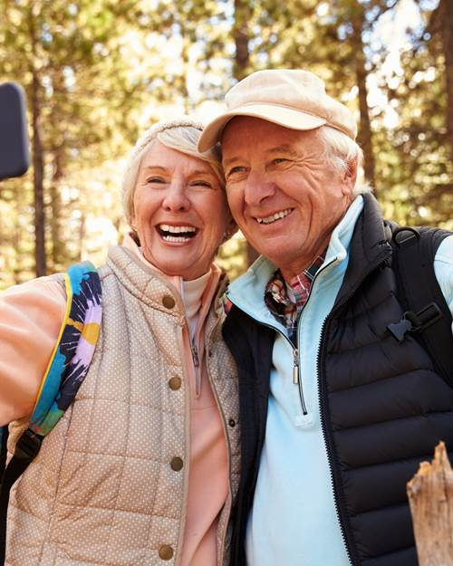 Senior couple in on hike taking a selfie
