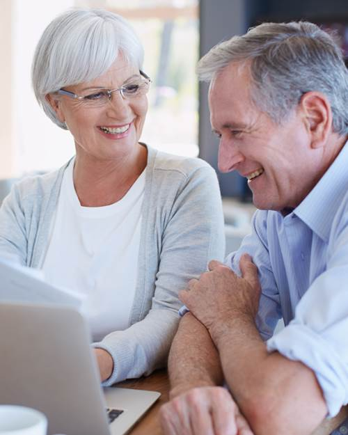 Elderly couple looking through finances