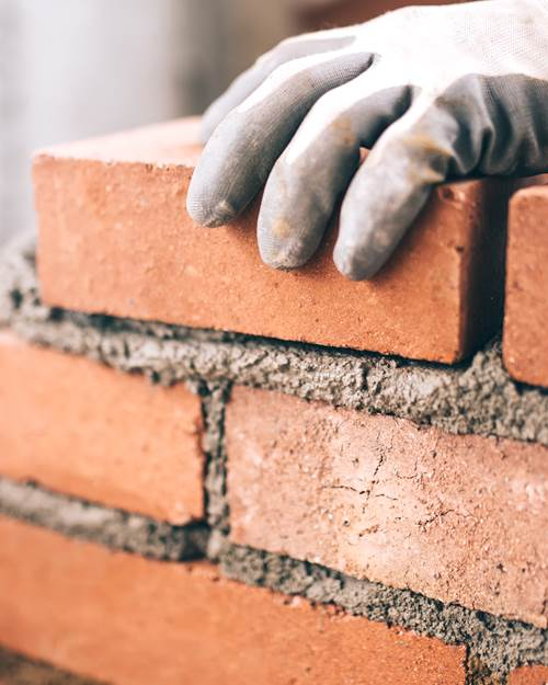 Wall being built using bricks
