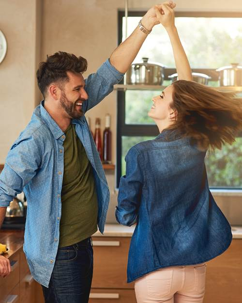 Young couple dancing in kitchen