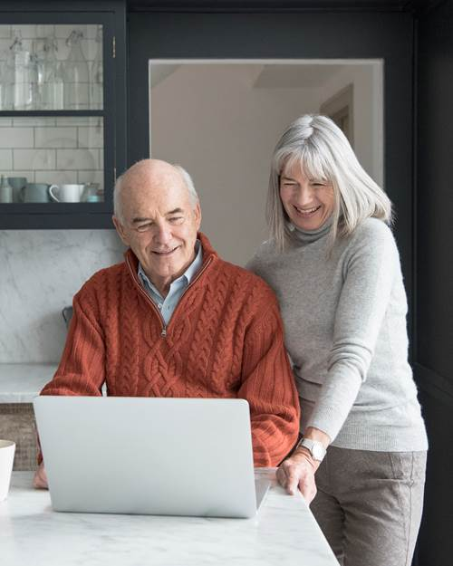 Senior couple looking on laptop