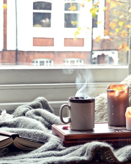 Cosy home with candles and coffee