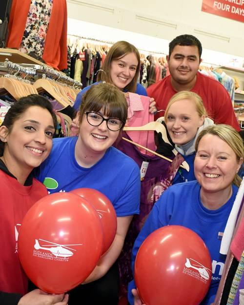 The Tipton staff with Midlands Air Ambulance staff in Midlands Air Ambulance Charity Shop