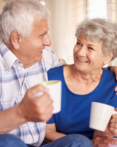 Old couple with cup of coffee