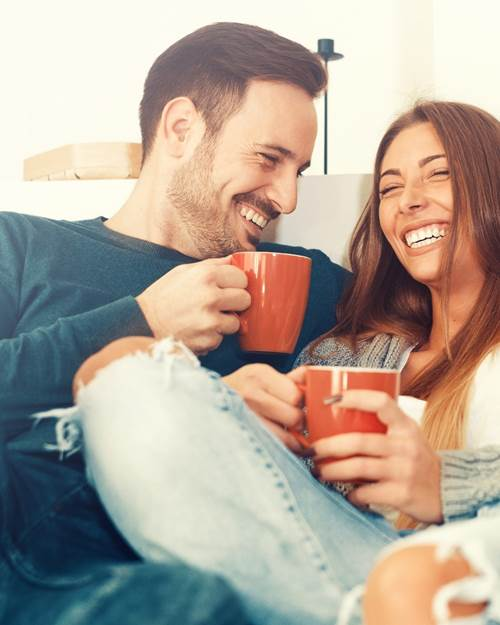 couple laughing with coffee